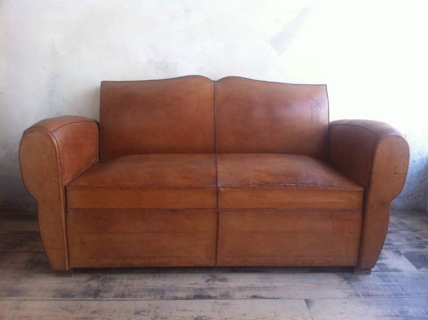 French leather Moustache back sofa