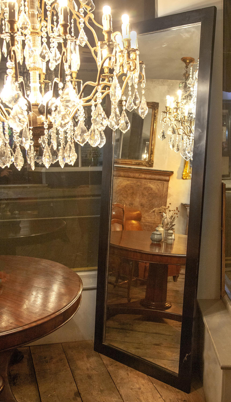 An Ebonised Tall Dressing or Shop Mirror