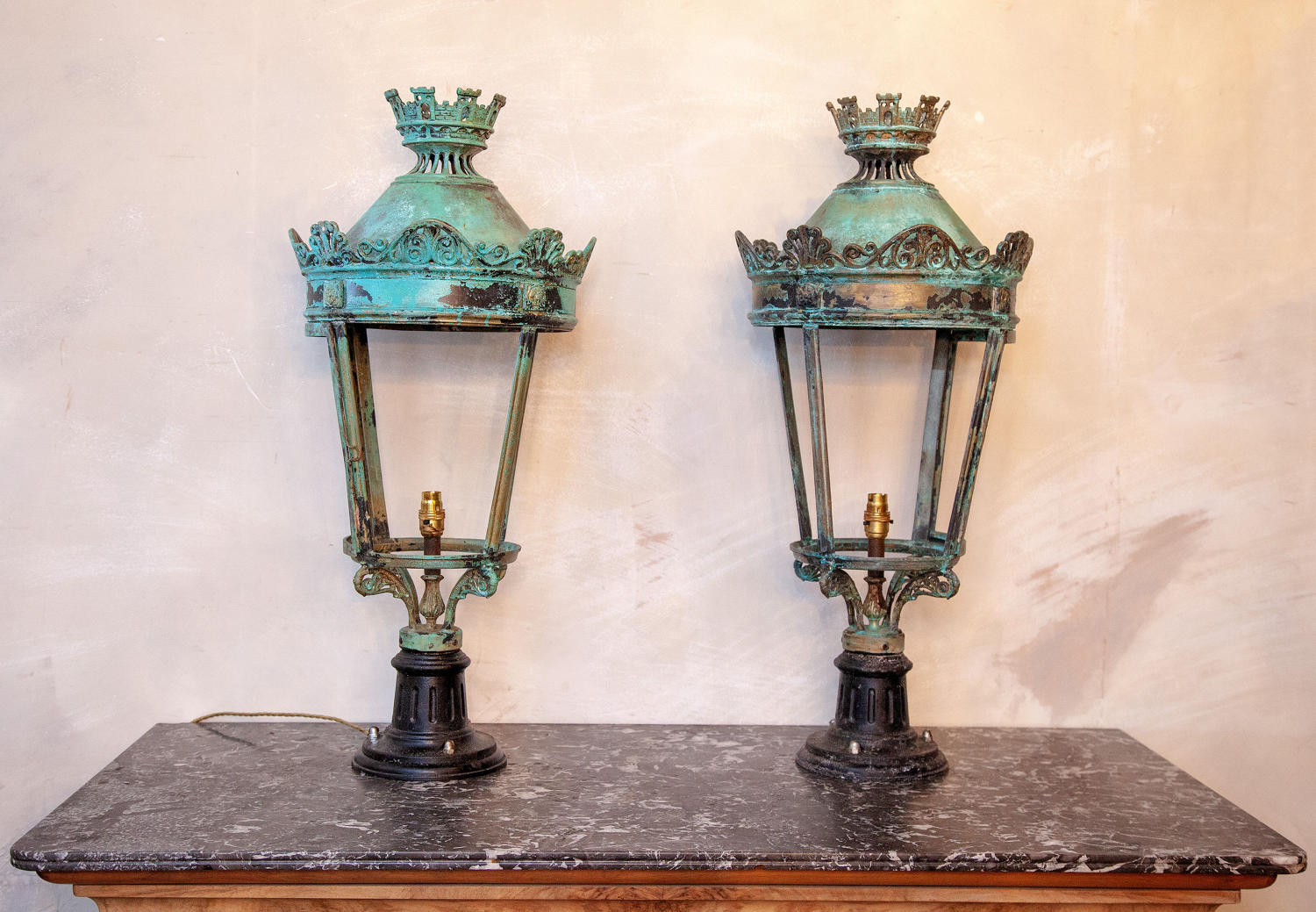 A stunning pair of patinated Verd Gris bronze lamps in the Regency sty