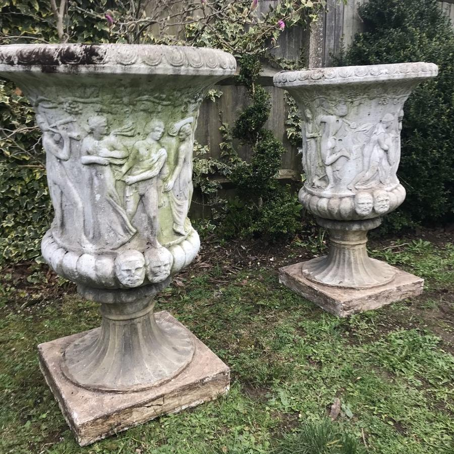 Pair of large relief moulded Medici Urns