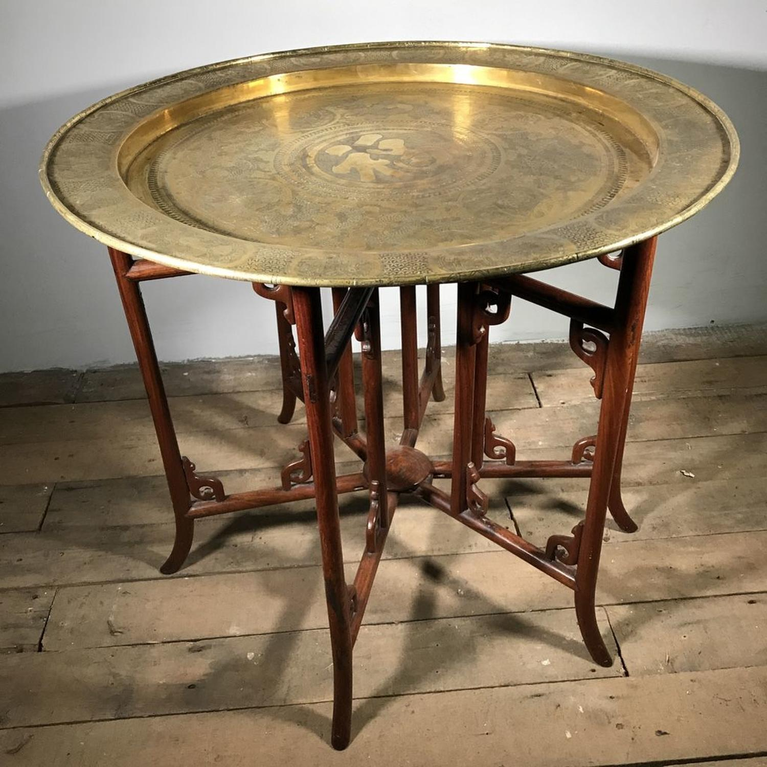 A CHINESE BRASS AND HUANG-HUALI CIRCULAR TRAY-TOP TABLE